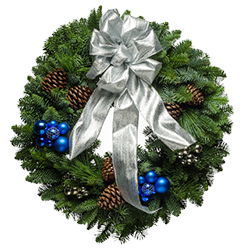 Fresh Christmas wreaths decorated with blue & silver ornaments and silver bows