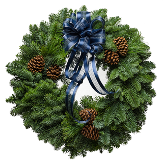 Pretty Christmas wreath decorated with a deep blue bow with silver threads