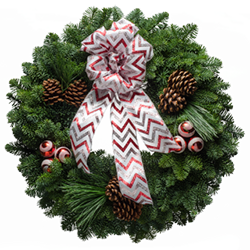 Fresh Christmas wreaths decorated with red swirl ornaments &  bow with red & silver chevrons