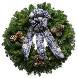 Hanukah wreath made from fresh evergreens and a blue Star of David bow
