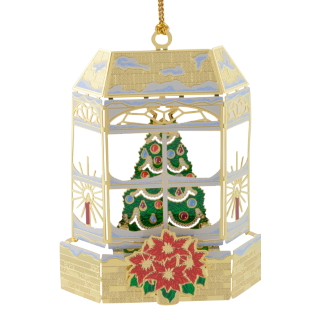 Brass Ornament depicts a window scene with a Christmas tree inside