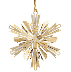 Gold colored snowflake ornament made from fine brass
