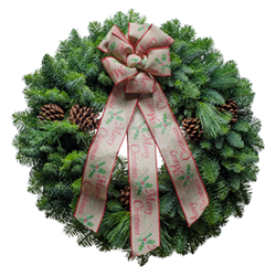 Merry Christmas is printed on the linen bow of this country style Christmas wreath