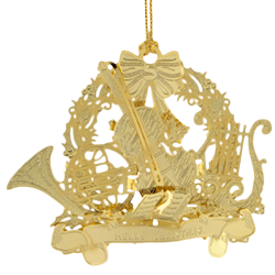 Brass Christmas ornament includes several musical instruments within a Christmas wreath