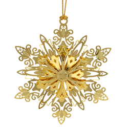 Brass Christmas tree ornament in the shape of a snowflake