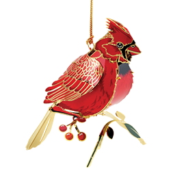 Red cardinal Christmas ornament that looks likea real red bird sitting on a branch