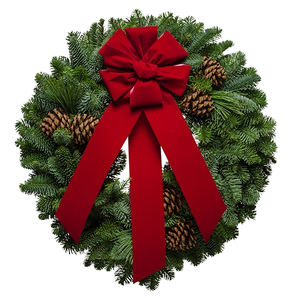 Fresh Rustic Christmas wreath decorated with a red velvet bow