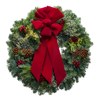 Fresh Christmas wreaths with colorful berries and a red velvet bow