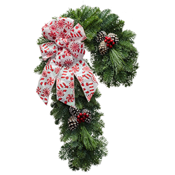 Fresh Christmas wreaths shaped like a candy cane topped with candy cane bow